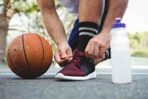 What are the Factors to Consider Before Buying Basketball Shoes for My Ankle Issue?